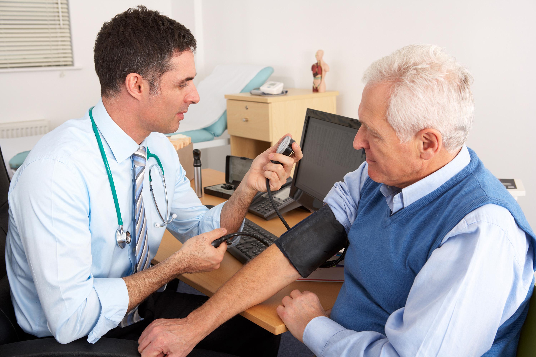 doctor blood pressure patient
