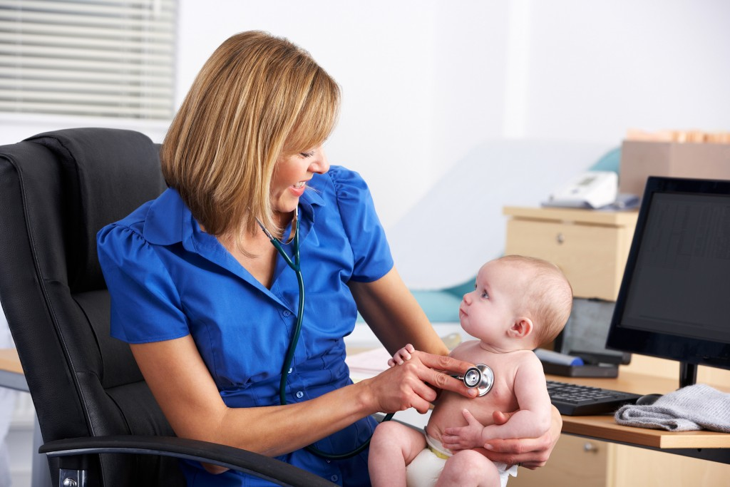 Doctor with baby